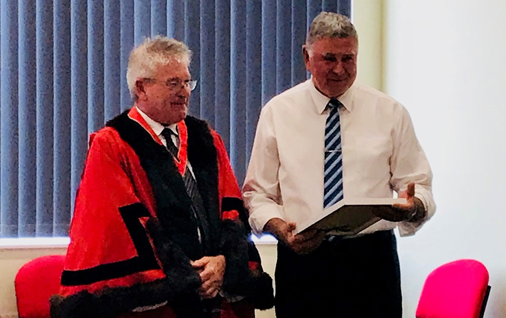 Kevin Bailey receiving his Australia Day award from the Mayor of the West Coast, Phil Vickers.