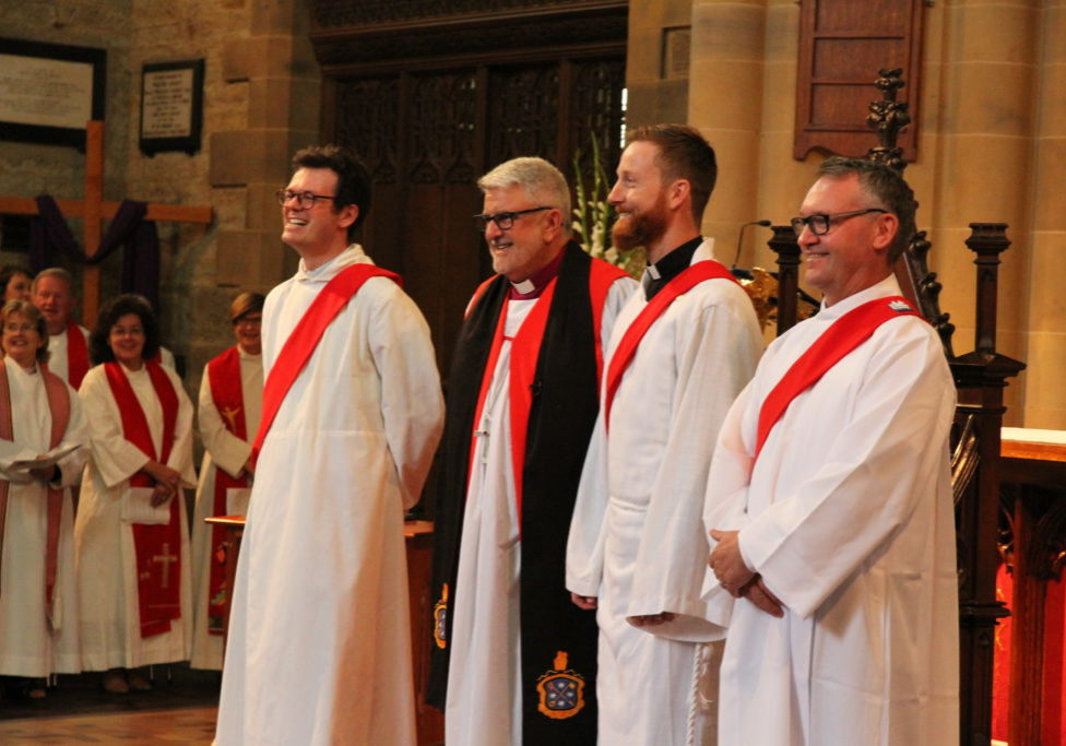 Bishop Richard with The Revds Tristan Dallas (left), Jacob Crane and Jamie Bester (right)